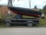Carrying your boat on the roof of the pickup. getting it off is always an adventure.