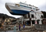 Don't park a yacht on a building. Or is this a houseboat?