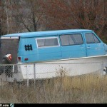 Live in an old van down by the river? Hah! This guy lives in an old van ON the river!