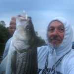 "First fish of the morning. Albino Shad, 9"" Slug-Go. Before the rain started the first time."
